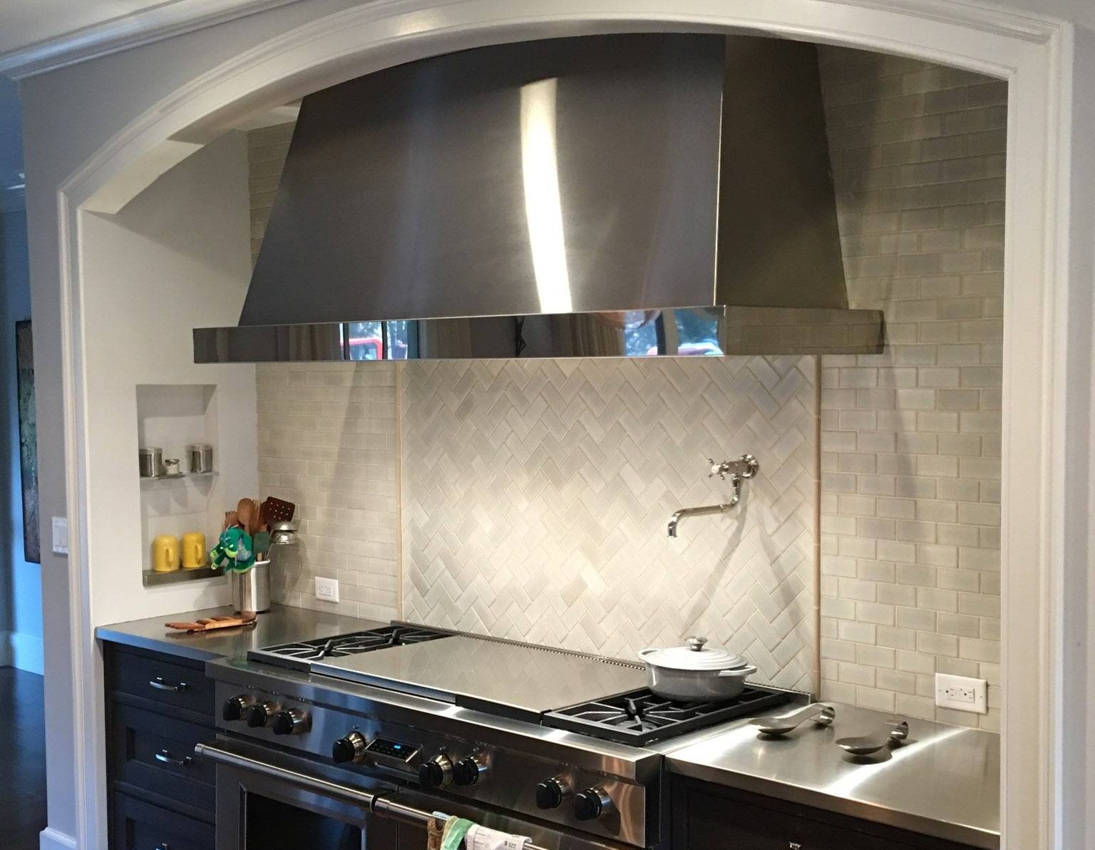 Wall mounted Chalet in stainless steel brushed with polished stainless steel trim.