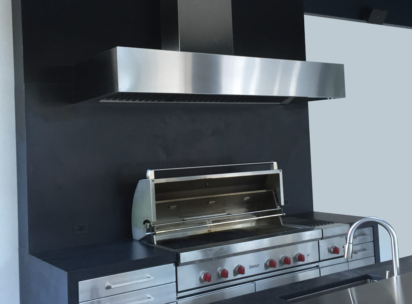 Wall mounted Cosmopolitan in brushed stainless steel.