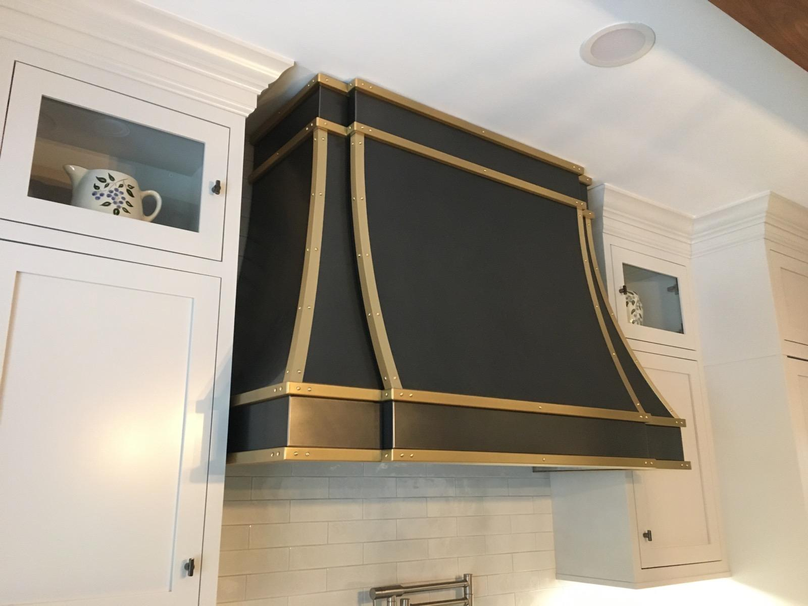 Wall mounted Sierra in black powdercoat with non-directional brass trim.