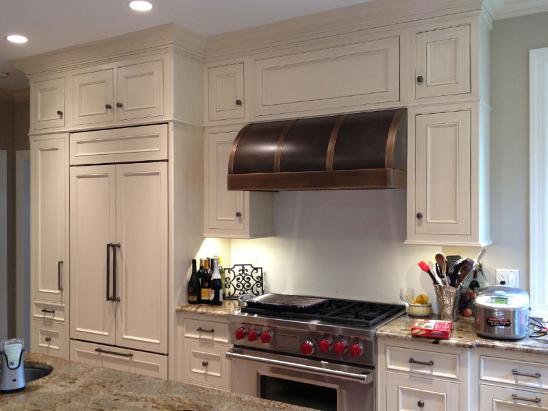 Wall mounted Canopy with an antique copper body, and antique brass bands and trim.