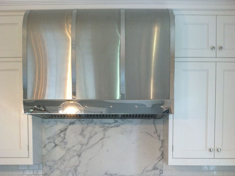 Wall mounted Canopy with a brushed stainless steel body and polished stainless steel bands and trim.