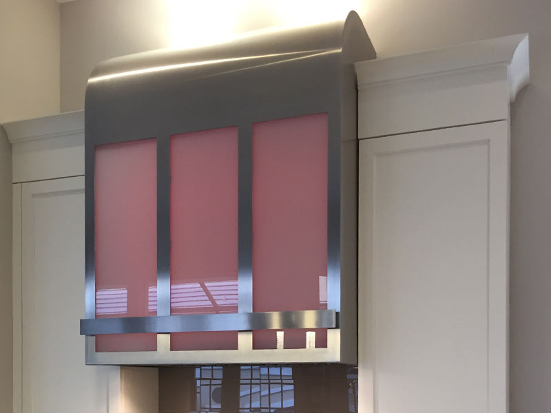 Wall mounted Canopy with a brushed stainless steel body, glass panels and pot rail.