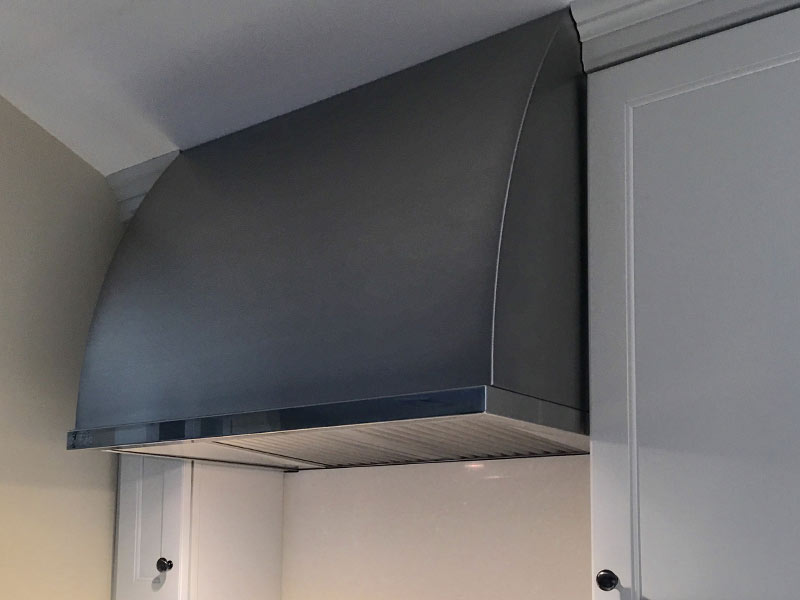 Wall mounted Canopy with a brushed stainless steel body.