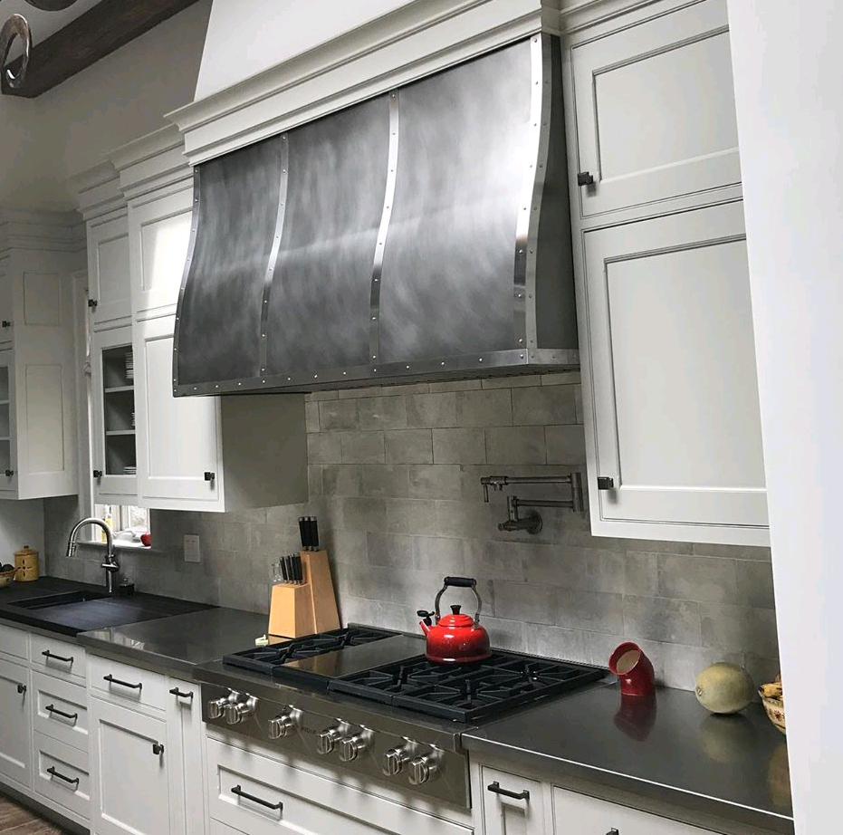 Wall mounted Venetian in antique stainless steel with polished stainless steel bands.